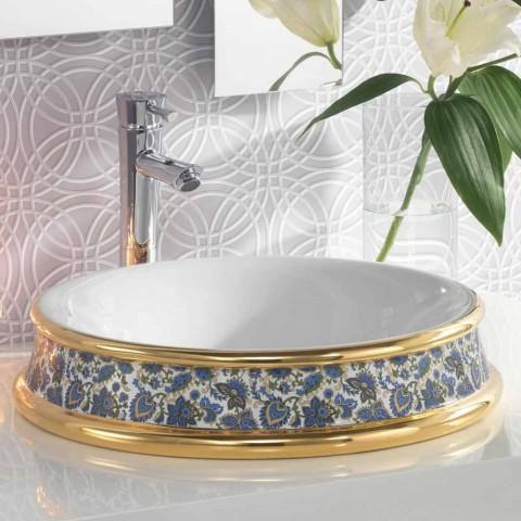 Halvhålt badrumssänk i eldlera och guld gjord i Italien, Manilo