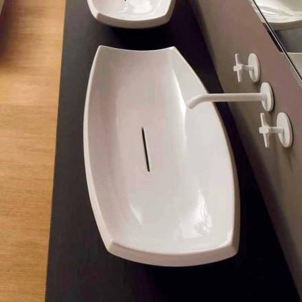 Vit keramiskt handfat med modern design gjord i Italien Laura