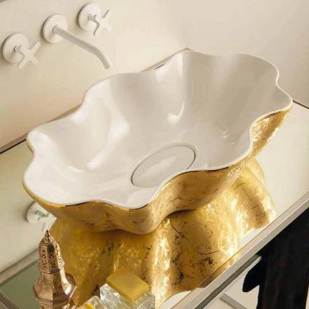 Handfat i bänkskivan i vit och guld keramik gjord i Italien Cubo