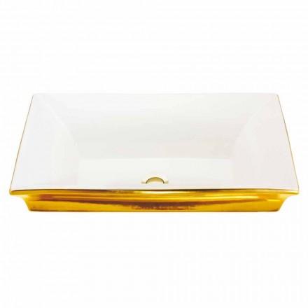 Modernt halvhålat sjunker i eldlera och 24 karat guld, Guido