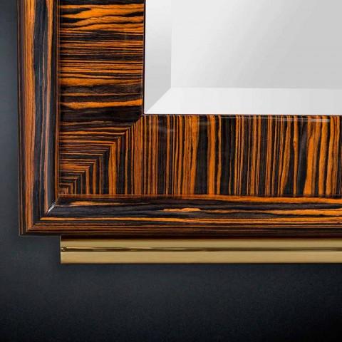 Avfasade spegel från väggen av polerad elfenben och metall Ada 1